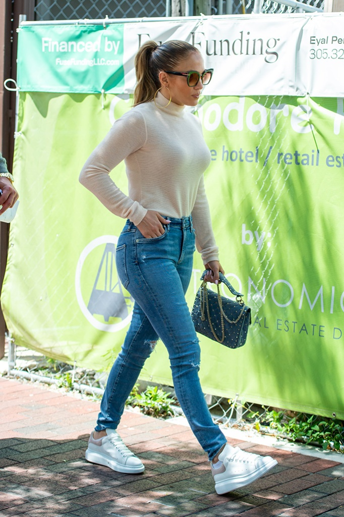 Jennifer Lopez, turtleneck sweater, skinny jeans, alexander mcqueen sneakers, celebrity style, tom ford sunglasses, valentino purse, ponytail, dresses down for a casual brunch at a Miami cafe with beau Alex Rodriguez before hopping into their customized Jeep. The Hollywood couple were spotted leaving Green Street Cafe, in Coconut Grove, on Wednesday (may 29). JLo wore sneakers and jeans for the outing, with a long sleeved top despite outdoor temperatures soaring to 80 degrees. She finished off the pared down 'Jenny from the Block' look with a pair of her trademark large gold hoop earrings personalized with 'Jennifer' on the inside curve.Pictured: Jennifer LopezRef: SPL5094095 290519 NON-EXCLUSIVEPicture by: AM / SplashNews.comSplash News and PicturesLos Angeles: 310-821-2666New York: 212-619-2666London: 0207 644 7656Milan: 02 4399 8577photodesk@splashnews.comWorld Rights