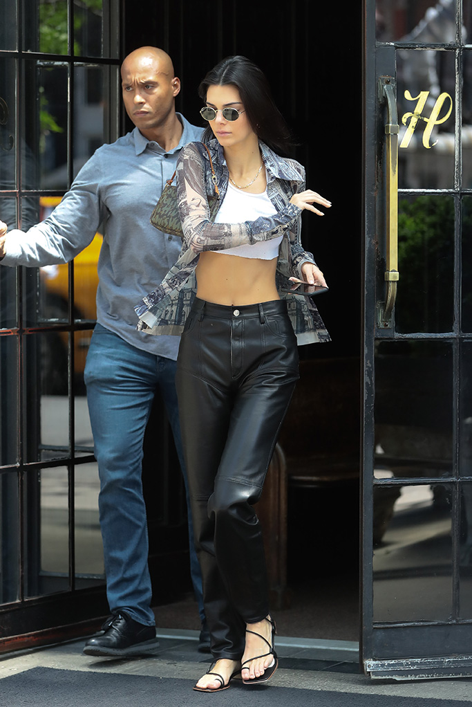 Kendall Jenner, crop top, acne studios button-down, mugler leather pants, gladiator sandals, feet, celebrity style, leaves her hotel in New YorkPictured: Kendall JennerRef: SPL5088576 110519 NON-EXCLUSIVEPicture by: SplashNews.comSplash News and PicturesLos Angeles: 310-821-2666New York: 212-619-2666London: 0207 644 7656Milan: 02 4399 8577photodesk@splashnews.comWorld Rights