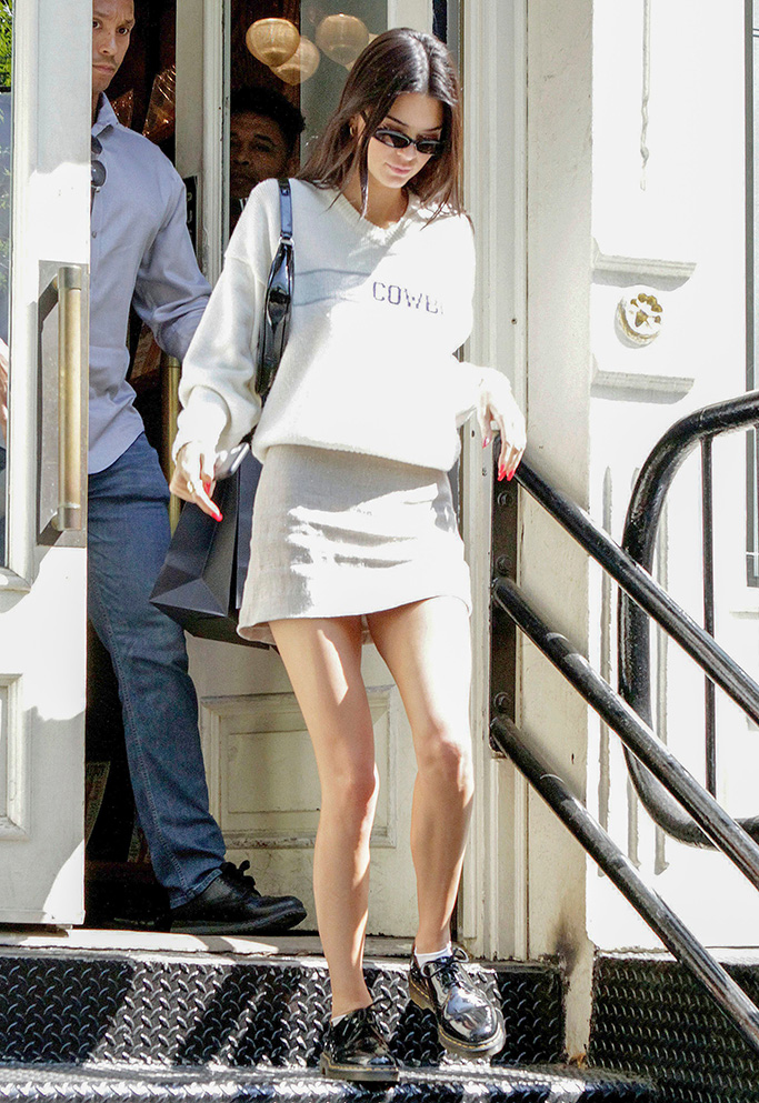 Kendall Jenner, dr. martens oxfords, miniskirt, legs, dallas cowboys sweater, celebrity style, linda farrow sunglasses, by far handbag, Kendall Jenner out and about, New York, USA - 08 May 2019