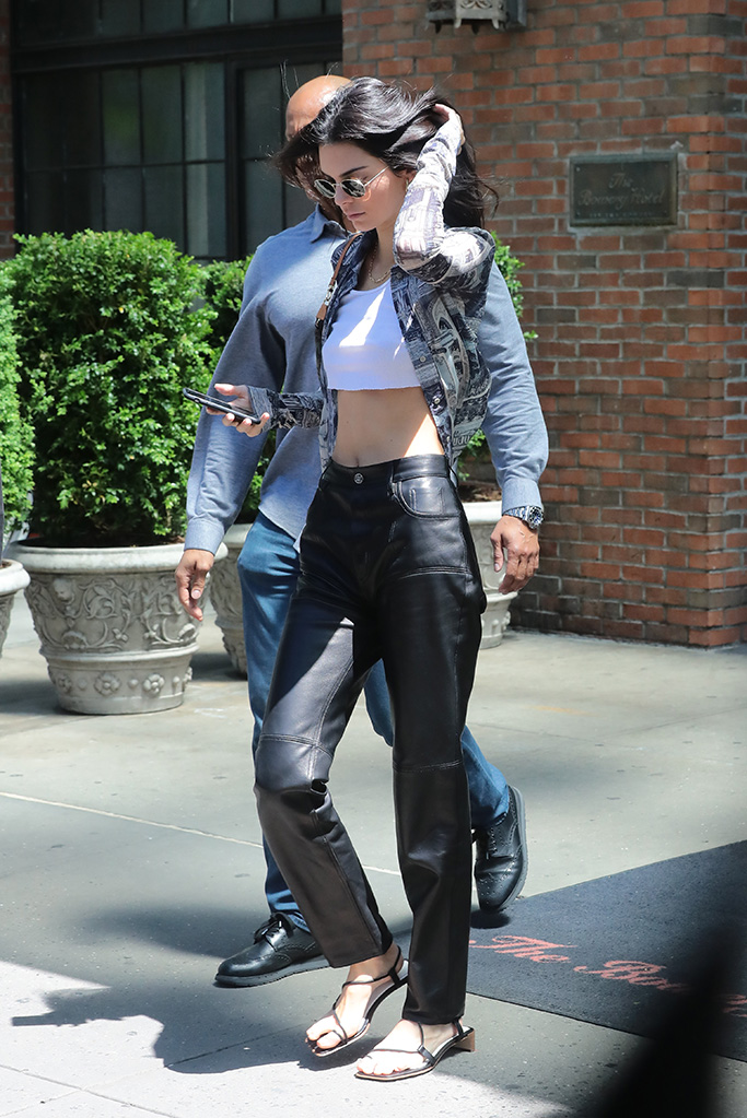 Kendall Jenner, mugler leather pants, black gladiator sandals, acne studios button-down, crop top, leaves her hotel in New YorkPictured: Kendall JennerRef: SPL5088576 110519 NON-EXCLUSIVEPicture by: SplashNews.comSplash News and PicturesLos Angeles: 310-821-2666New York: 212-619-2666London: 0207 644 7656Milan: 02 4399 8577photodesk@splashnews.comWorld Rights