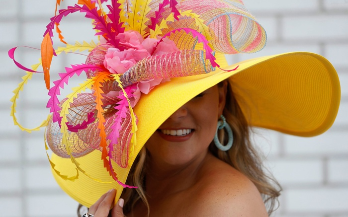 A woman wears a hat during the 145th running of the Kentucky Derby horse race at Churchill Downs, in Louisville, KyKentucky Derby Horse Racing, Louisville, USA - 04 May 2019