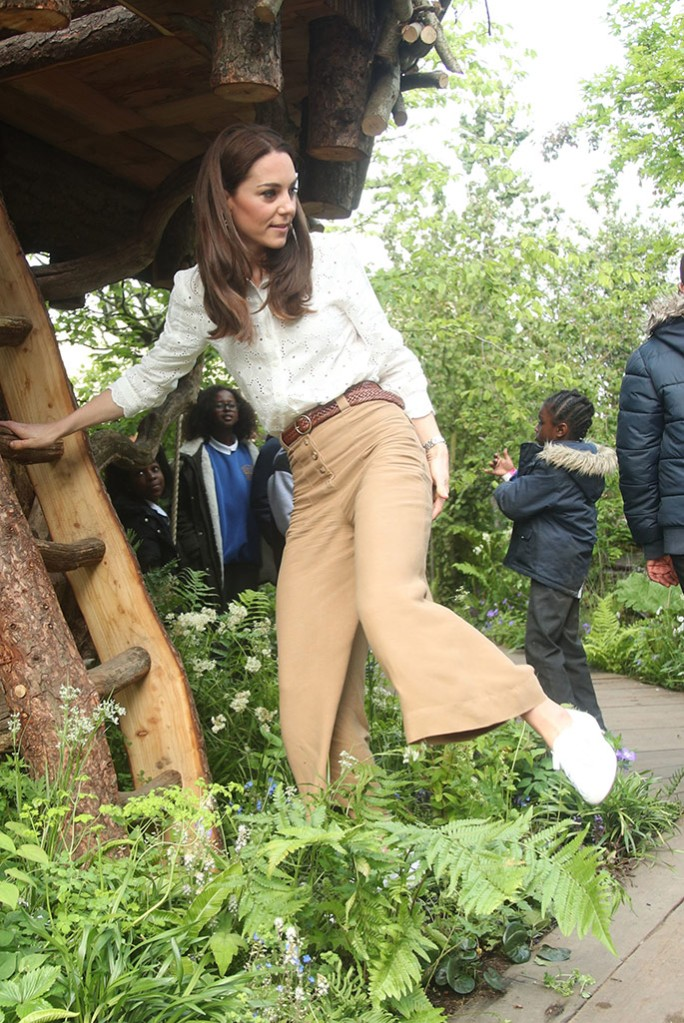 Kate Middleton climbs a tree in Superga sneakers at The Chelsea Flower Show.