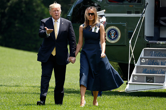 melania trump, calvin klein navy dress, white christian louboutin pumps, stilettos, celebrity style, first lady, Donald Trump, Melania Trump. President Donald Trump gestures toward members of the media as he returns to the White House while holding hands with first lady Melania Trump, in Washington, after their trip to JapanTrump, Washington, USA - 28 May 2019