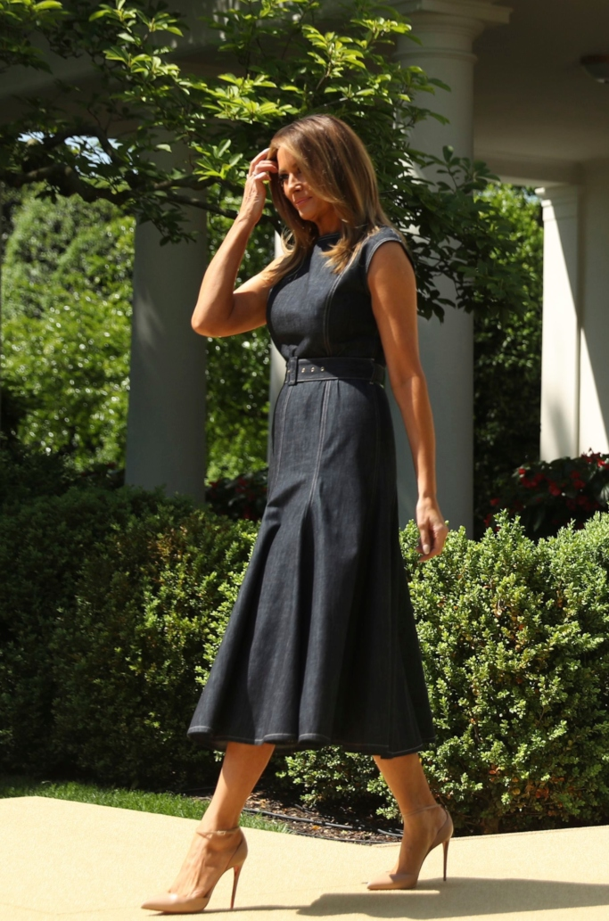 melania trump, emilia wickstead Ellen belted denim midi dress, be best campaign anniversary, christian louboutin nude leather ankle-strap pumps