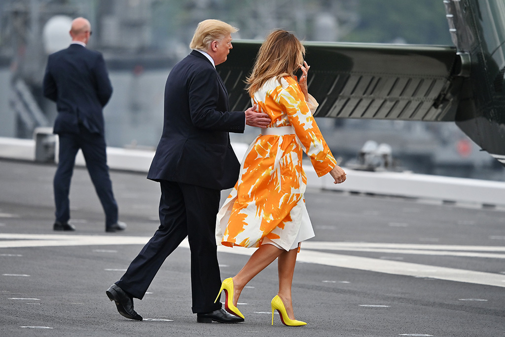 US President Donald J. Trump (L) walks on deck with First Lady Melania (R) during a visit to the Japanese Navy destroyer J.S Kaga (DDH-184), in Yokosuka, Japan, 28 May 2019. US President Trump is on a four day state visit to Japan.US President Donald Trump visits Japan, Yokosuka - 28 May 2019