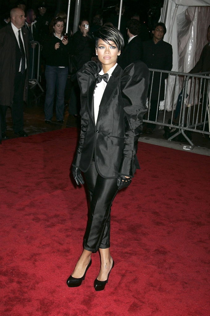 Rihanna, dolce and gabbana tuxedo, black pumps, 'The Model as Muse: Embodying Fashion' Benefit Gala at the Metropolitan Museum of Art Costume Institute, New York, America - 04 May 2009Last night saw the glamorous and the glorious put on their glad rags and head down to one of the biggest events in the US fashion industry calendar – the Met Costume Institute Gala.With a theme of 'Model As Muse', the night was sponsored by Marc Jacobs who was the star guest of the evening and was accompanied by his main muse of the evening, Kate Moss.Although the number of tickets sold was down on last year, those that rebuffed the credit crunch were treated to a rich array of the most famously beautiful models in the world.Marc Jacobs dressed Kate Moss (a gold lame backless, one shouldered mini dress with a matching turban) and Victoria Beckham (a pink mini dress with black polka dots and a long train) while Louis Vuitton kitted out Madonna with a turquoise ruched mini dress with puffed skirt, thigh-high black boots, jewelled black fingerless gloves and a hair piece tied around a top knot to complete the odd 80s-inspired look.
