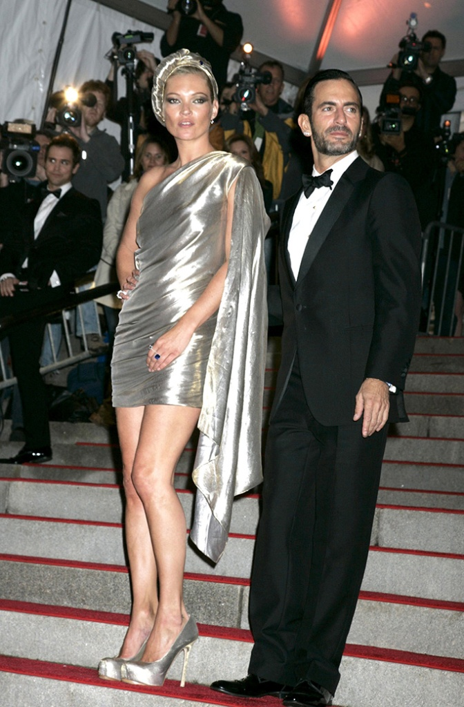 Kate Moss and Marc Jacobs'The Model as Muse: Embodying Fashion' Benefit Gala at the Metropolitan Museum of Art Costume Institute, New York, America - 04 May 2009 Last night saw the glamorous and the glorious put on their glad rags and head down to one of the biggest events in the US fashion industry calendar – the Met Costume Institute Gala. With a theme of 'Model As Muse', the night was sponsored by Marc Jacobs who was the star guest of the evening and was accompanied by his main muse of the evening, Kate Moss. Although the number of tickets sold was down on last year, those that rebuffed the credit crunch were treated to a rich array of the most famously beautiful models in the world. Marc Jacobs dressed Kate Moss (a gold lame backless, one shouldered mini dress with a matching turban) and Victoria Beckham (a pink mini dress with black polka dots and a long train) while Louis Vuitton kitted out Madonna with a turquoise ruched mini dress with puffed skirt, thigh-high black boots, jewelled black fingerless gloves and a hair piece tied around a top knot to complete the odd 80s-inspired look.