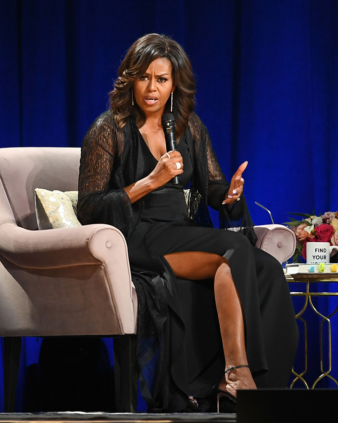 Former First Lady Michelle Obama, jumpsuit, legs, black ankle strap sandals, celebrity style, 'Becoming' book tour, Florida, USA - 10 May 2019
