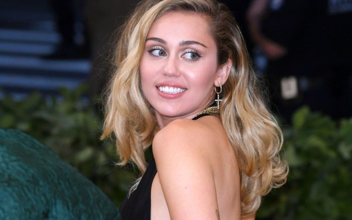 Miley Cyrus S Vegan Versace Sandals Elevate A Flashy Outfit In Italy Footwear News