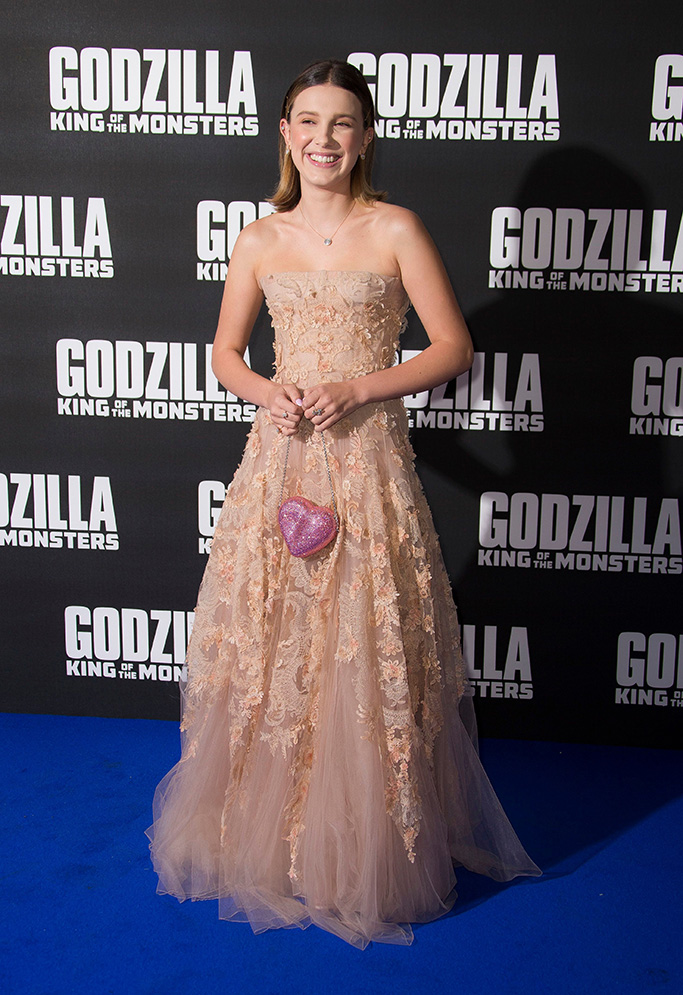Millie Bobby Brown, dior dress, tabitha simmons shoes, poses for photographers upon arrival at the screening for Godzilla II: King of the Monsters, at a central London cinemaGodzilla II: King of the Monsters Screening, London, United Kingdom - 28 May 2019