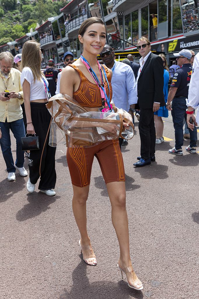 olivia culpo, fendi, crop top, bike shorts, manolo blahnik, strappy see-through sandals, celebrity style, Bob Sinclar stroll along the pit lane at the 77th Monaco Grand Prix, Monaco on May 26th, 2019. Photo by Marco Piovanotto/ABACAPRESS.COMPictured: Ref: SPL5093605 260519 NON-EXCLUSIVEPicture by: AbacaPress / SplashNews.comSplash News and PicturesLos Angeles: 310-821-2666New York: 212-619-2666London: 0207 644 7656Milan: 02 4399 8577photodesk@splashnews.comUnited Arab Emirates Rights, Australia Rights, Bahrain Rights, Canada Rights, Finland Rights, Greece Rights, India Rights, Israel Rights, South Korea Rights, New Zealand Rights, Qatar Rights, Saudi Arabia Rights, Singapore Rights, Thailand Rights, Taiwan Rights, United Kingdom Rights, United States of America Rights