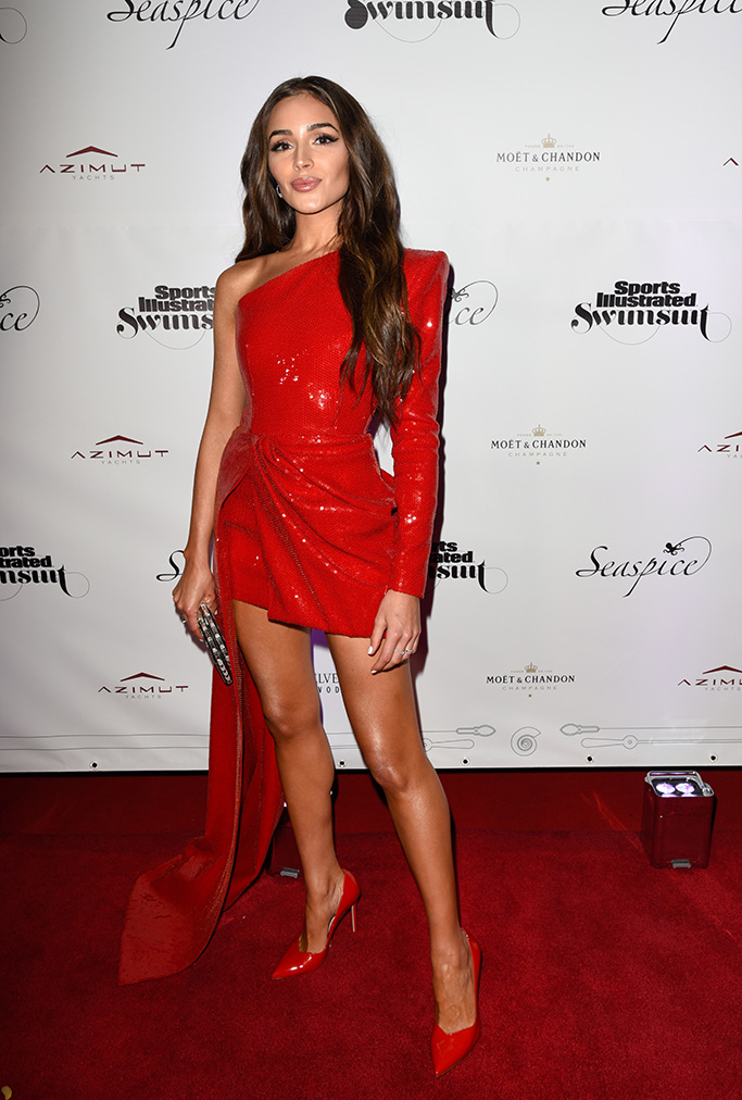 Olivia Culpo, sparkly red minidress, celebrity style, legs, red pumps, high heels, Sports Illustrated Swimsuit On Location, Seaspice, Miami, USA - 10 May 2019