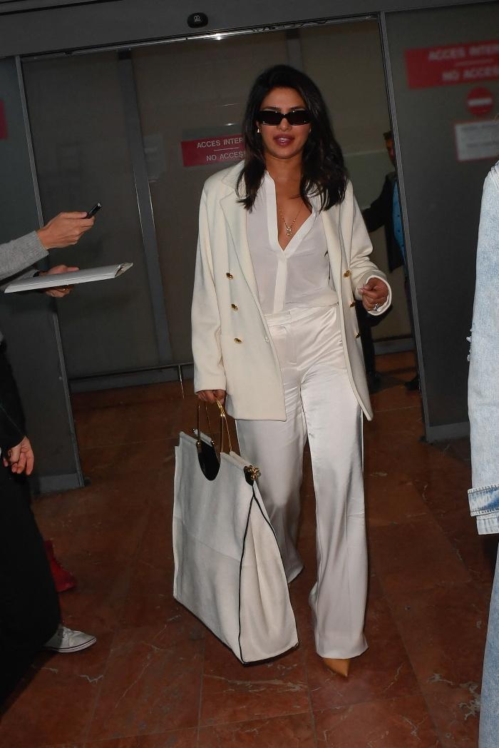 priyanka chopra, all white, pants, white bag, nude heels, nice airport, cannes film festival