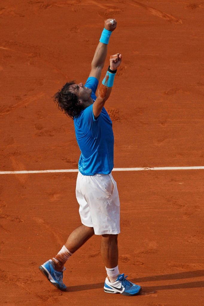 Rafael Nadal of Spain celebrates defeating Roger Federer of Switzerland in four sets, 7-5, 7-6, 5-7, 6-1, in the men's final of the French Open tennis tournament in Roland Garros stadium in ParisTennis French Open, Paris, France - 5 Jun 2011