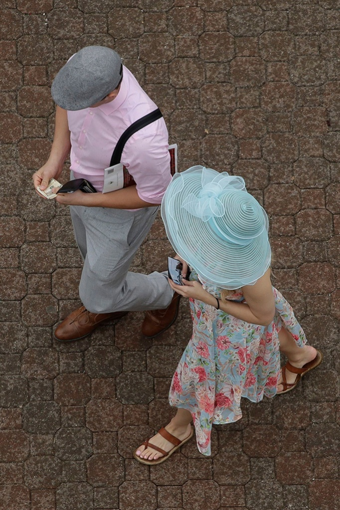 A couple arrive at Churchill Downs, before the 145th running of the Kentucky Derby horse race in Louisville, KyKentucky Derby Horse Racing, Louisville, USA - 04 May 2019