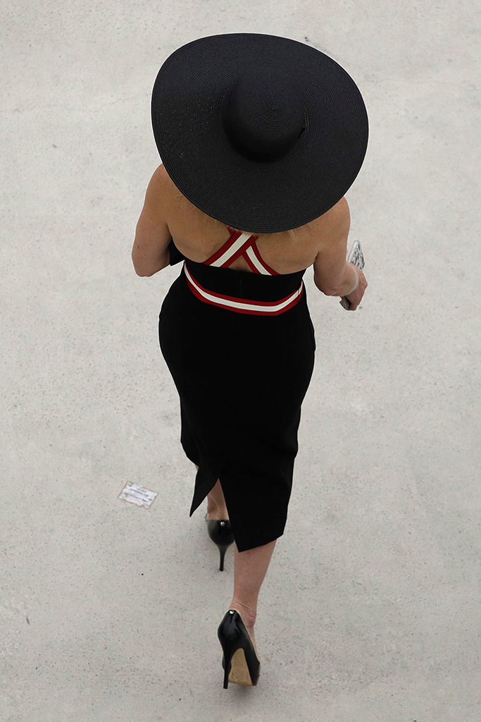 A woman wears a hat as she arrives at Churchill Downs, before the 145th running of the Kentucky Derby horse race in Louisville, KyKentucky Derby Horse Racing, Louisville, USA - 04 May 2019