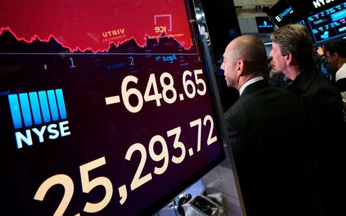 An electronic screen shows the drop in the Dow Industrials, at the New York Stock Exchange. U.S. stocks moved sharply lower Monday on Wall Street and extended the market's slide into a second week as investors seek shelter from an escalating trade war between the U.S. and ChinaFinancial Markets Wall Street, New York, USA - 13 May 2019
