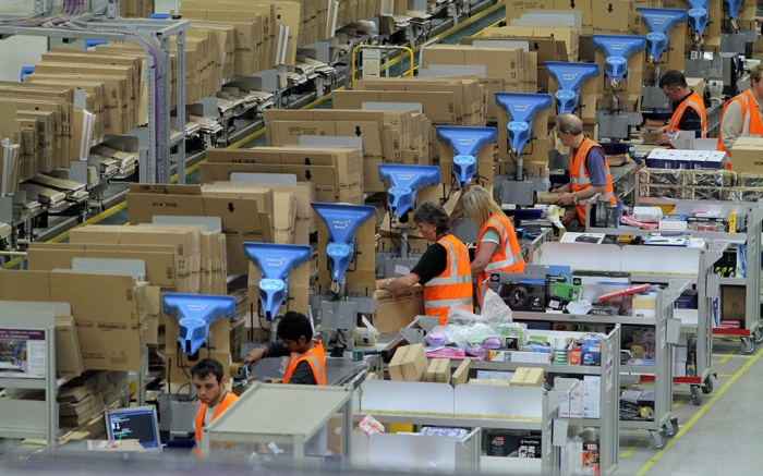 Workers at an Amazon fulfillment center
