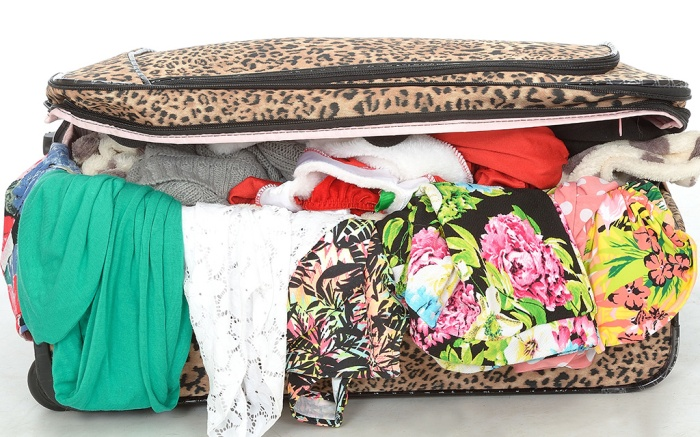 Model Released - Overflowing Full Suitcase Unable to Close With Clothes Spilling Out UnzippedYoung woman - 29 Apr 2015