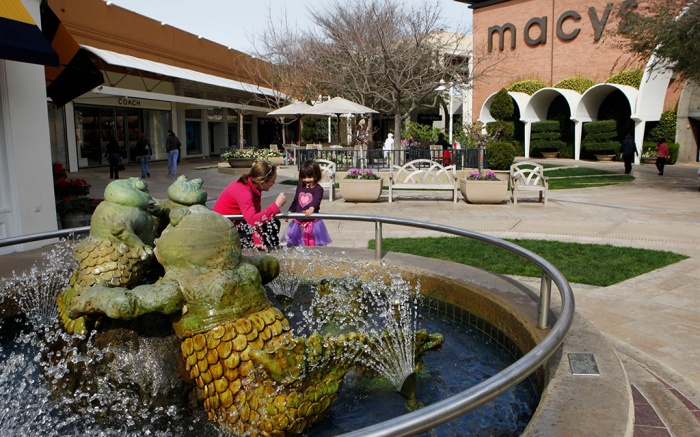 Stanford Shopping Center; Simon Property Group A woman and a young girl stand at a fountain at the Stanford Shopping Center, a Simon Property Group property, in Palo Alto, Calif. Simon Property Group on said it is launching a hostile bid worth about $16 billion for Macerich Co., after saying the rival mall operator refused to discuss a combinationMall Operators Hostile Bid, Palo Alto, USA