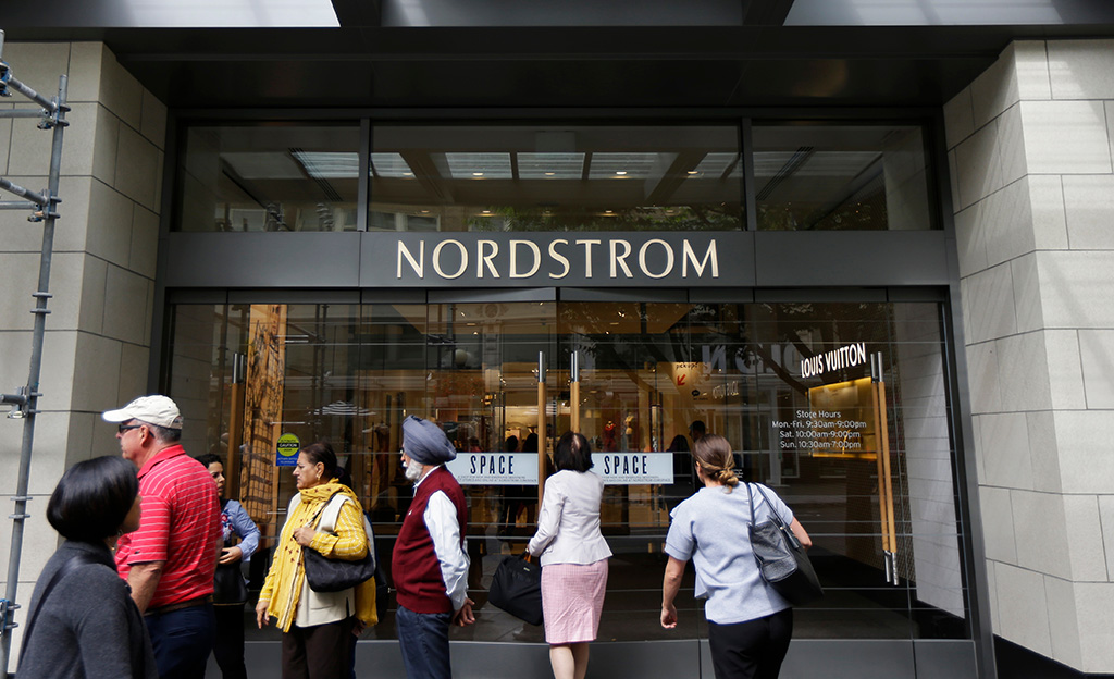 People stand near an entrance for Nordstrom Inc.'s flagship store in downtown Seattle
