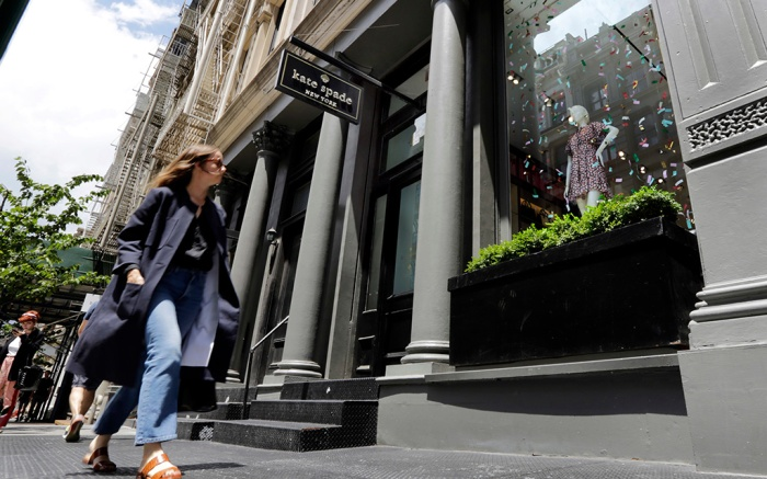 A woman walks by the Kate Spade store in New York's Soho neighborhood, . Spade was found hanged in her apartment Tuesday in an apparent suicide, law enforcement officials saidKate Spade Death, New York, USA - 05 Jun 2018
