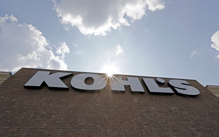 The sun peeks over a sign in front of a Kohl's store in Concord, N.CEarns Kohls, Concord, USA - 28 Aug 2018