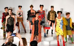 Models present creations by young fashion