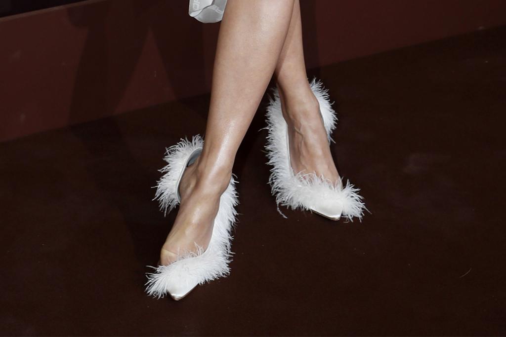 rita ora, cannes film festival, magnum, vivienne westwood dress, white dress, necklace, furry heels