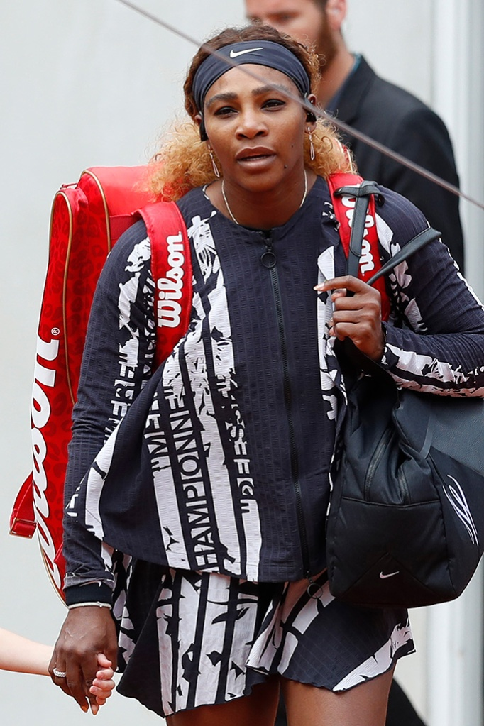 "Serena Williams, nike x off-white, french, mother champion queen goddess, celebrity style, of the U.S. wears a jacket with French text reading ""Champion"", ""Queen"", ""Godess"", and ""Mother"" after warming up prior to her first round match of the French Open tennis tournament against Vitalia Diatchenko of Russia at the Roland Garros stadium in ParisTennis French Open, Paris, France - 27 May 2019"