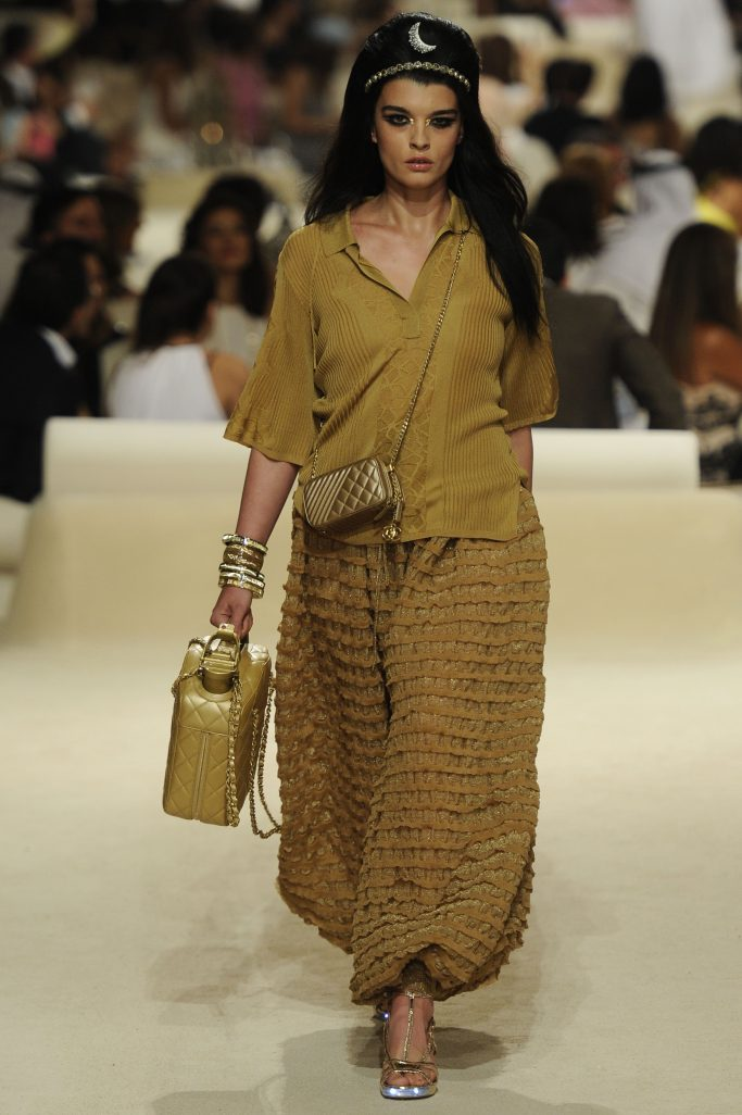 A model on the runway at the Chanel 2015 resort show at the Island.Chanel Resort 2015 RTW, Dubai