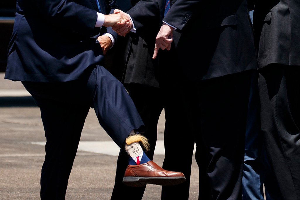 socks, combover hair, President Donald Trump points to the socks of Lt. Gov. Billy Nungesser, R-La., after arriving at Chennault International Airport, in Lake Charles, LaTrump, Lake Charles, USA - 14 May 2019