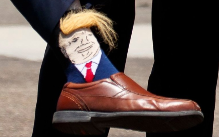 President Donald Trump points to the socks of Lt. Gov. Billy Nungesser, R-La., after arriving at Chennault International Airport, in Lake Charles, LaTrump, Lake Charles, USA - 14 May 2019