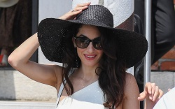 Amal Clooney, white one-shoulder dress, black