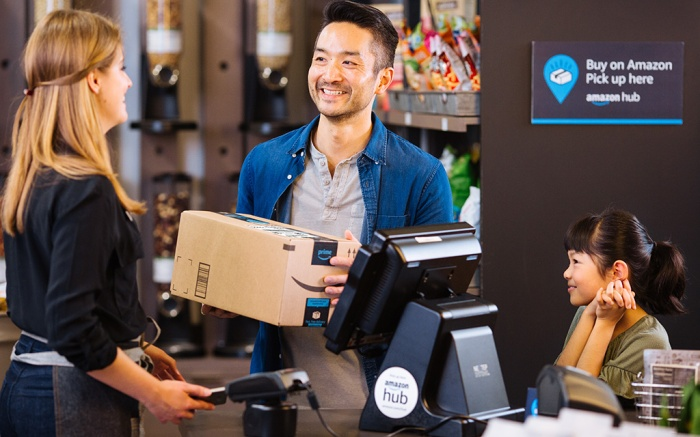 A customer picks up his package at an Amazon Hub Counter