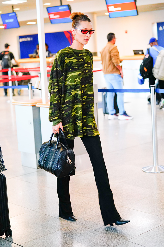 Bella Hadid at JFK airport in New York wearing camoPictured: Bella Hadid Ref: SPL5098287 160619 NON-EXCLUSIVE Picture by: Jackson Lee / SplashNews.com Splash News and Pictures Los Angeles: 310-821-2666 New York: 212-619-2666 London: 0207 644 7656 Milan: 02 4399 8577 photodesk@splashnews.com World Rights, No Portugal Rights