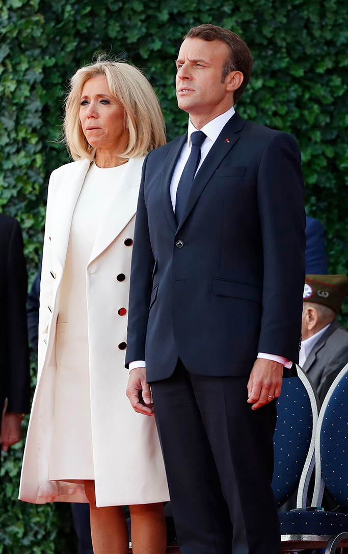 French President Emmanuel Macron and Brigitte Trogneux participate in a ceremony to commemorate the 75th anniversary of D-Day at the American Normandy cemetery, in Colleville-sur-Mer, Normandy, FranceTrump D-Day 75 Years, Colleville-sur-Mer, France - 06 Jun 2019