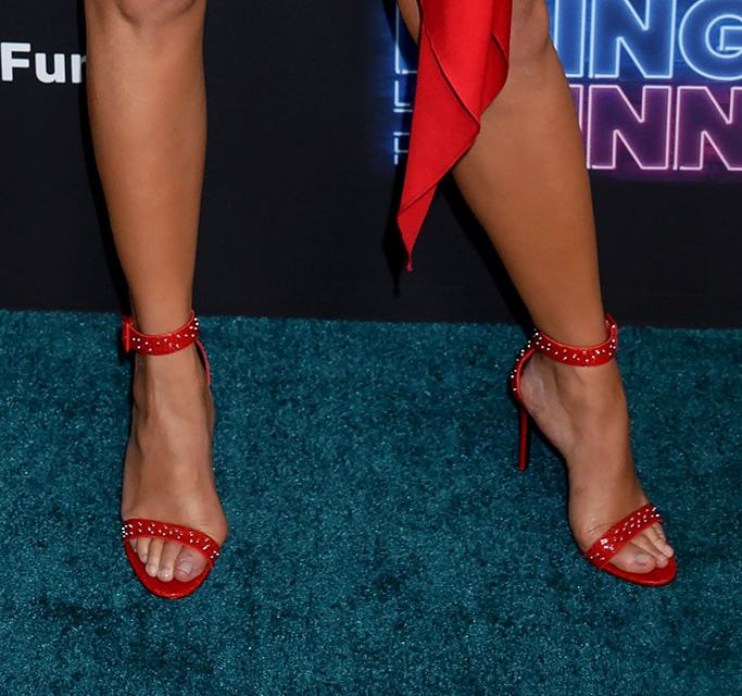 Giuseppe Zanotti, Red Reptile Embossed Sandal with Grommet stud detail, lChrissy Teigen feet, red sandals, buckle closure, legs, bring the funny premiere