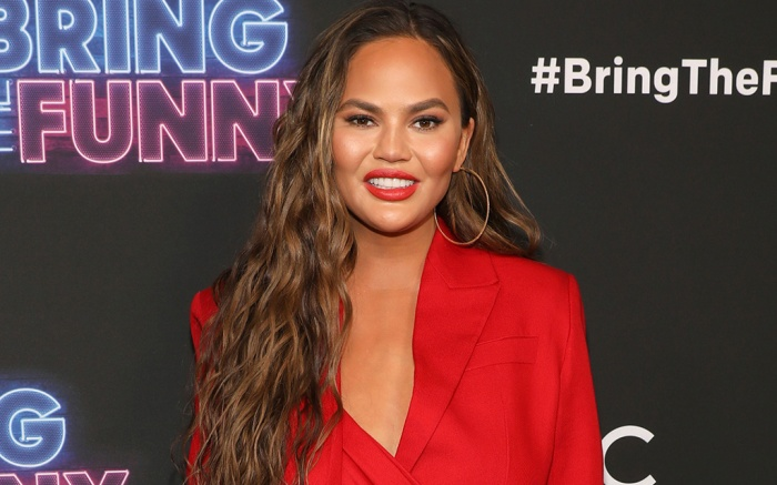 Chrissy Teigen feet, red sandals, crystal embellishment, buckle closure, legs, bring the funny premiere
