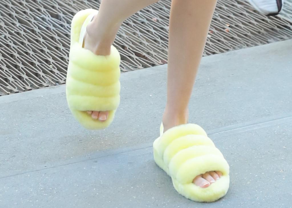 gigi hadid, ugg fluff yeah slides, feet, yellow sandals