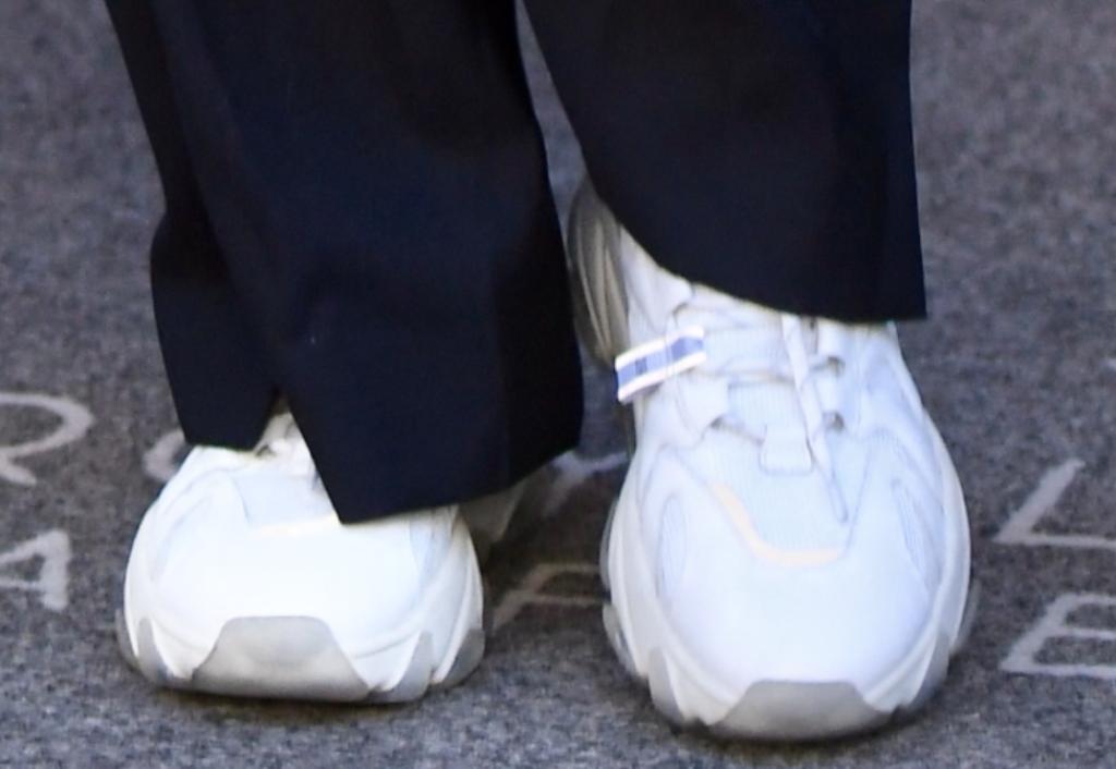 gigi hadid wearing white sneakers