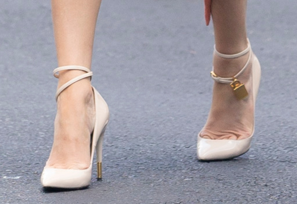 jennifer lopez, tom ford pumps with gold heel, wrap-around ankle straps that are strung with the brand's signature 'Padlock' and key