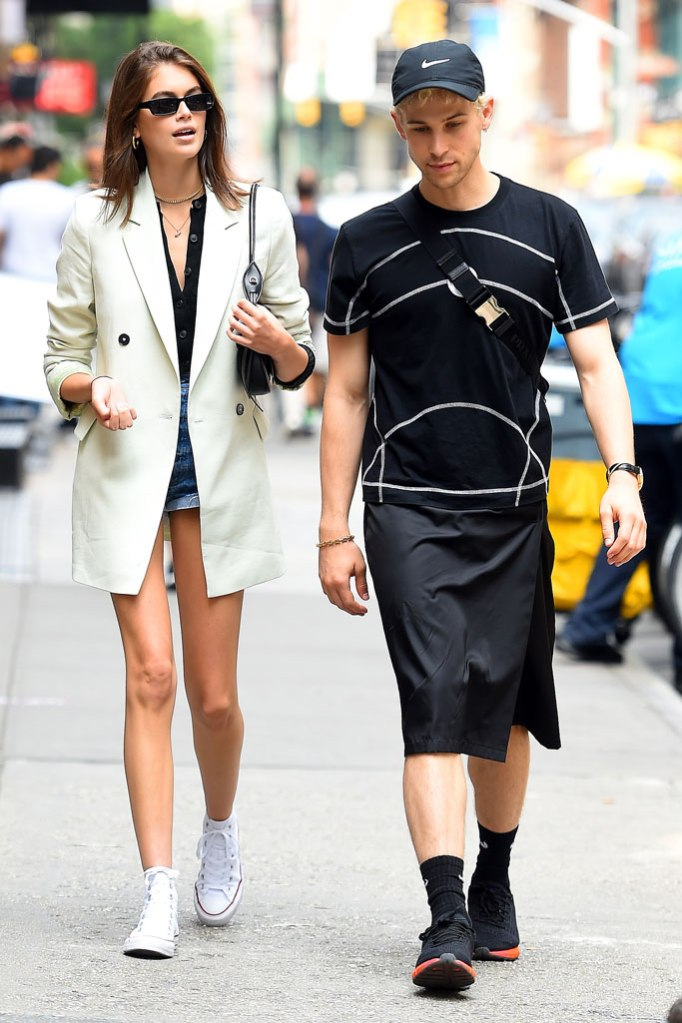 Kaia Gerber, converse sneakers, legs, supermodel, celebrity style, converse chuck taylor all star sneakers, palm angels x moncler sunglasses, prada bag, tommy dorfman, under armour pride sneakers, nike hat, basketball shorts