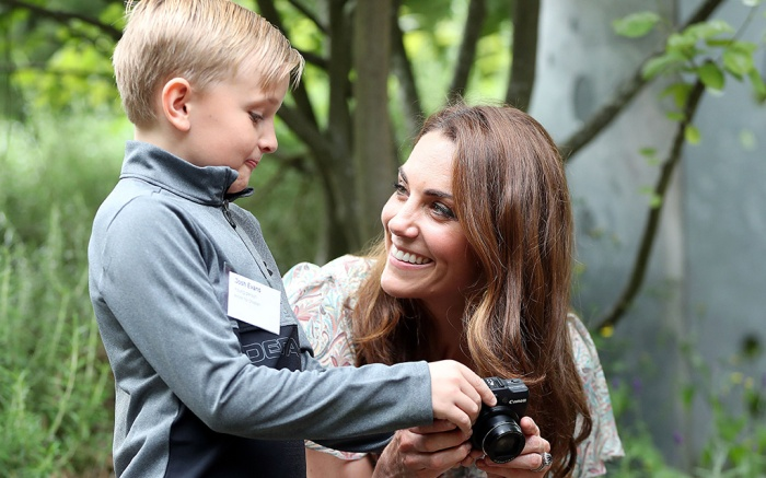 Catherine Duchess of Cambridge speaks with Josh Evans at a photography workshop for Action for Children, run by the Royal Photographic Society150th Anniversary of Action for Children, Warren Park, Kingston, London, UK - 25 Jun 2019