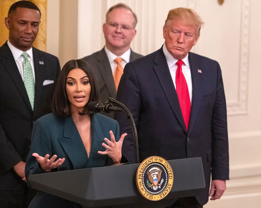 United States President Donald J. Trump, right, listens as Kim Kardashian makes remarks during an event on on second chance hiring in the East Room of the White House'Second Chance Hiring' press conference, Washington DC, USA - 13 Jun 2019