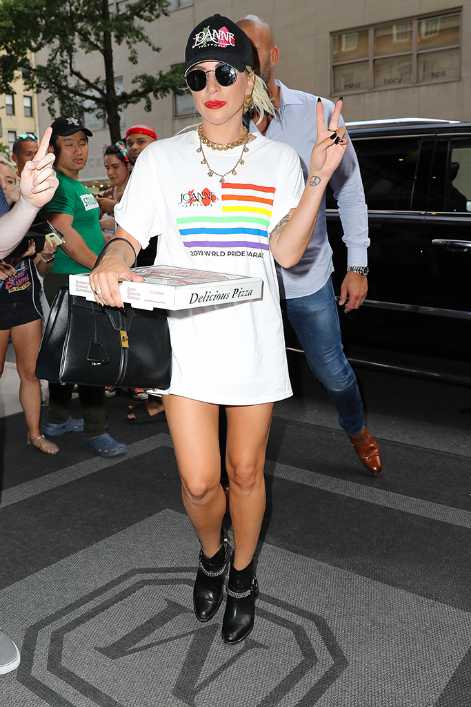 Lady Gaga throws a peace sign while carrying her pizza from Joanne in New York CityPictured: Lady GagaRef: SPL5101093 280619 NON-EXCLUSIVEPicture by: Felipe Ramales / SplashNews.comSplash News and PicturesLos Angeles: 310-821-2666New York: 212-619-2666London: 0207 644 7656Milan: 02 4399 8577photodesk@splashnews.comWorld Rights