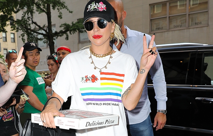 Lady Gaga Throws A Peace Sign While Carrying Her Pizza From Joanne In New York City