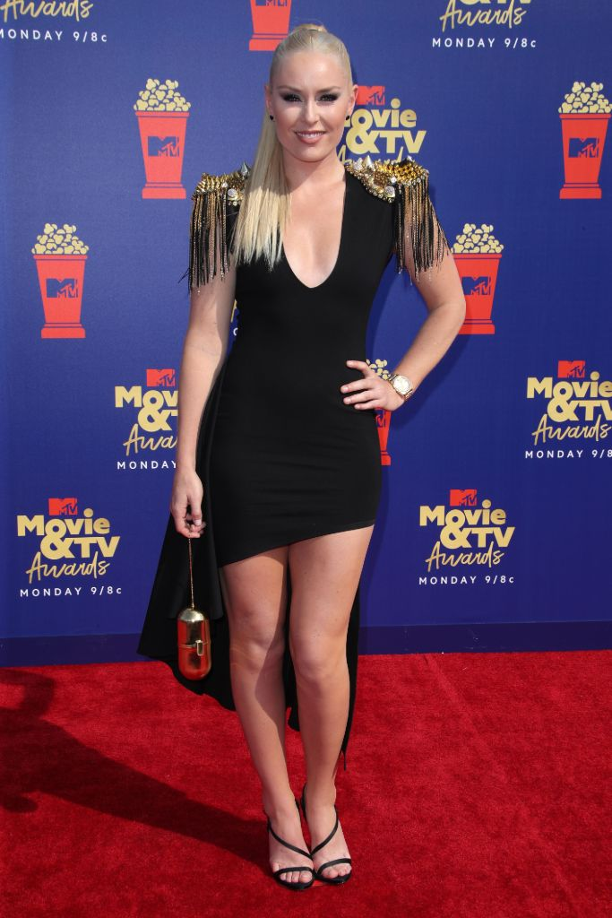 Lindsey Vonn arrives at the 2019 MTV Movie awards in a high-low dress and barely-there sandals.