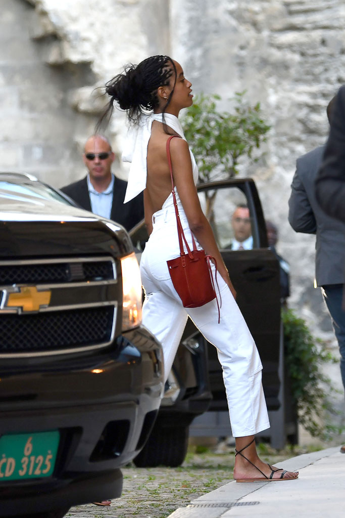Malia Obama, celebrity style, halter top, white jeans, flat strappy sandals, avignon france, family vacation, summer 2019
