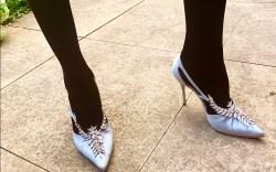 Manolo Blahnik provide the footwear for